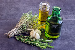 Spices, herbs and garlic, olive oil next to a bottle Stock Photo