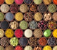 Spices and herbs isolated on black background. Various spices for food stock photos