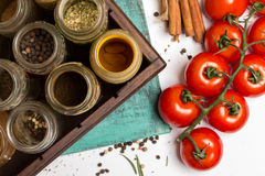 Spices and herbs jars. Food, cuisine ingredients, cherry tomatoes, cinnamon Stock Images