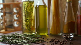 Spices and herbs on kitchen table. Closeup of cooking ingredients. stock footage