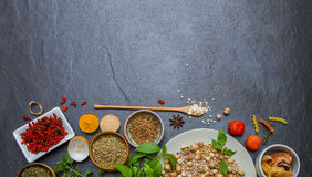 Spices and herbs in metal bowls background for decorate and desi Stock Photos