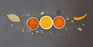Spices and herbs in metal bowls. Stock Image