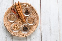 Spices and herbs on old kitchen table. Food and cuisine ingredie Stock Image