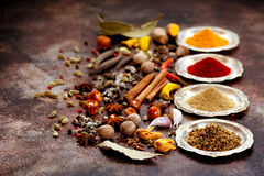 Spices and herbs on old kitchen table. Royalty Free Stock Photos
