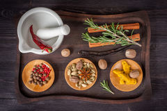 Spices and herbs on an old tray Stock Image