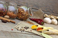 Spices and herbs on old vintage wooden boards Royalty Free Stock Photo