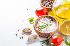Spices, herbs and olive oil over white stone table. Food cooking background with Copy space stock photos