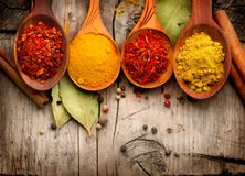 Spices and herbs over wood Royalty Free Stock Photos