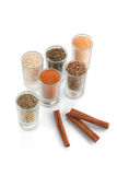 Spices and herbs in small glass with cinnamon Royalty Free Stock Image