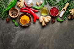 Spices, herbs and various other culinary ingredients background. Flat lay, overhead view, space for a text Royalty Free Stock Image
