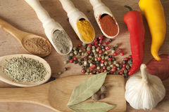 Spices herbs and vegetables on desk Royalty Free Stock Images