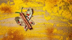 Spices and herbs for website headers. Seasoning scattered on table in the form of a butterfly, background for packing with food. Space for text royalty free stock image