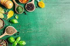 Spices and herbs on wooden background stock image