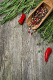 Spices and herbs on a wooden background (and space for text) Stock Photography