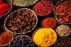 Spices and herbs in wooden bowls. royalty free stock photo