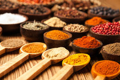 Spices and herbs in wooden bowls. Food and cuisine ingredients Royalty Free Stock Photography