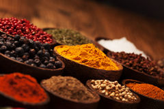 Spices and herbs in wooden bowls. Stock Photo