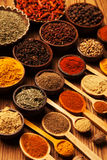Spices and herbs in wooden bowls. Royalty Free Stock Image