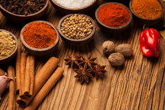 Spices and herbs in wooden bowls. royalty free stock photos