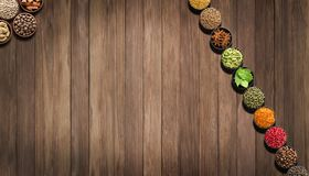 Spices and herbs on  wooden table. seasoning for food, top view. Royalty Free Stock Photo