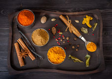Spices and herbs in a wooden vintage tray Royalty Free Stock Photo