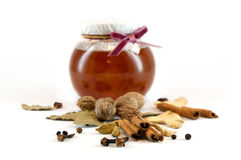 Spices and honey Stock Photos