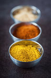 Spices. Hot spices on rustic background Stock Photo