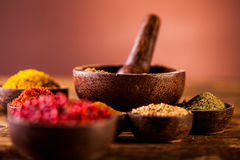 Spices in Indonesian wooden bowls Stock Photo