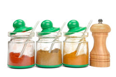 Spices in jars and mill Royalty Free Stock Photography