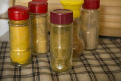 Spices in jars. Turmeric, hops - suneli, ginger, dry vegetables, seasoning. Close-up stock photography