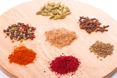 Spices on the kitchen board Royalty Free Stock Photography