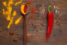 Spices, a large wooden spoon and red pepper on a dark background. Background with spices.spices. Top view. Close up. The concept of spices for cooking,  copy Stock Photo