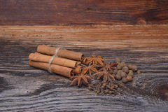 Spices lying on a wooden surface. Spices lying on a wooden Stock Photos
