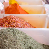 Spices on the market in white containers. Royalty Free Stock Photography