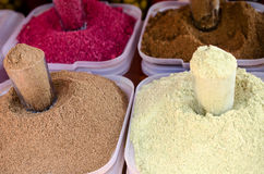Spices on the market in white containers. Royalty Free Stock Images