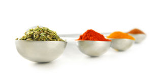 Spices in measuring spoons Royalty Free Stock Photography