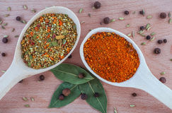 Spices for meat dishes in a wooden spoon on the wood. Chopping board Stock Photo
