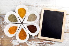 Spices with menu board Royalty Free Stock Photography