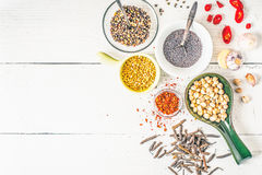 Spices of Middle East , Caucasian and Asian cuisine on the white table horizontal Royalty Free Stock Photography