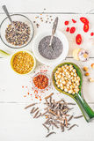Spices of Middle East , Caucasian and Asian cuisine on the white table vertical Royalty Free Stock Photo