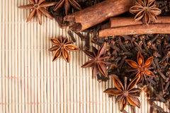 Spices for mulled wine on bamboo background Royalty Free Stock Photography