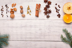 Spices for mulled wine glintwine on wooden background Royalty Free Stock Images
