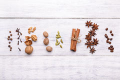 Spices for mulled wine glintwine on wooden background Stock Images