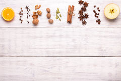 Spices for mulled wine glintwine on wooden background Royalty Free Stock Photo