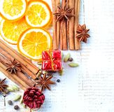 Spices for mulled wine on a white wooden background. Christmas, New Year background. Royalty Free Stock Photos