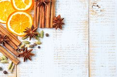 Spices for mulled wine on a white wooden background. Christmas, New Year background. Stock Image