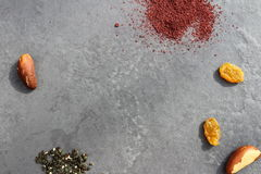 Spices and nuts on a black background. Zaatar ans sumac spices with brazilian nuts and raisins on a black background Stock Photo