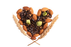 Spices and nuts in heart shape Stock Photo