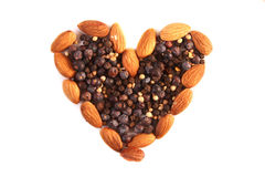 Spices and nuts in heart shape Royalty Free Stock Photography