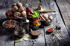 Spices and nuts at wooden table Royalty Free Stock Photo